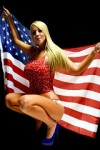 Hope Daylee in a sexy pose holding the American flag